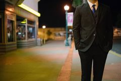 Man in Black Suit Near Stores on Street Royalty Free Stock Photos