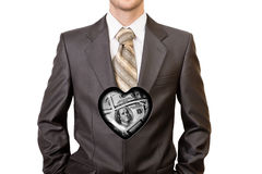 Man in black suit with one hundred dollar heart inside him Royalty Free Stock Images