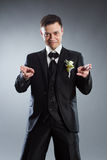 Man in black suit pointing fingers in front Royalty Free Stock Image