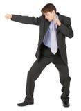 Man in black suit, punching Stock Photos