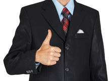 Man in black suit showing a thumbs up Royalty Free Stock Image