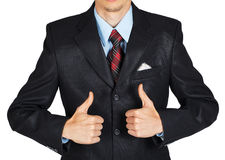 Man in black suit showing a thumbs up Stock Images