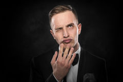Man in black suit thinking or dreaming. Stock Photography