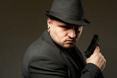 Man in black suite with gun. Stock Photography