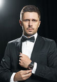 Man in black suite whit watch Stock Photography