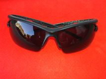 Man black sunglasses isolated on red  background royalty free stock photos