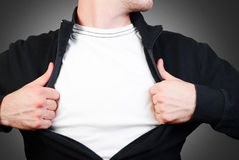 Man in a black sweater. Man pulling open shirt showing white t shirt Stock Photos