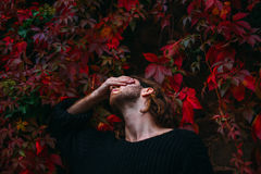 Man in Black Sweater Covering Eyes With Right Hand Stock Photography