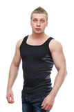 Man in black t-shirt. One handsome Caucasian musculan male in black t-shirt isolated on white background Royalty Free Stock Photos