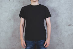Man in black t-shirt Stock Images