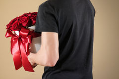 Man in black t shirt holding in hand rich gift bouquet of 21 red Royalty Free Stock Images