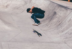 Man in Black Taking a Trick on Skate Board Stock Photos