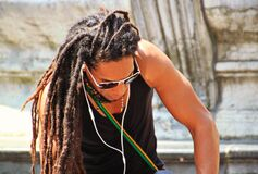 Man in Black Tank Top With Braided Hair Royalty Free Stock Photography