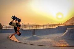 Man In Black Tank Top Skateboarding Wearing Helmet stock image