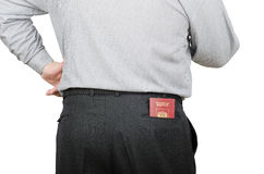 Man in black trousers has Russian passport in back pocket. Standing man in black trousers has Russian passport in back pocket on white background Royalty Free Stock Photo
