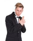 Man in black tuxedo with gun hand gesture Royalty Free Stock Photography
