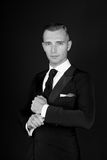 Man in a black tuxedo suit and white shirt Stock Photo