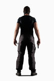 Man in black uniform with gun isolated on white royalty free stock photography