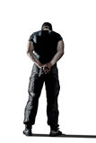 Man in black uniform and mask standing with gun isolated. Standing man with gun wearing black military uniform isolated on white background, behind view stock photos