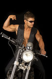 Man black vest bike flex look side Royalty Free Stock Photography