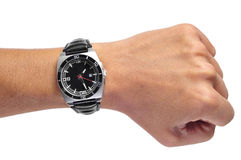 Man black watch. A men wearing a black watch with black leather strap over a white background Stock Photos