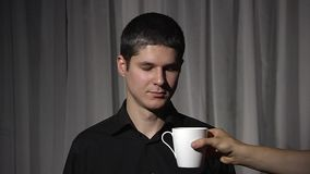 Man in black with white cup. Drinks. stock video