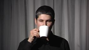 Man in black with white cup. stock footage
