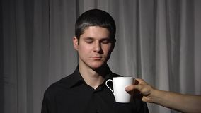 Man in black with white cup. stock video