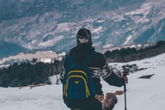 Man in Black and White Jacket and Blue Backpack Doing Snow Ski Royalty Free Stock Photos