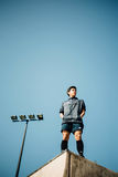 Man in Black Zip Up Jacket Standing on Edge of Roof Top Royalty Free Stock Image
