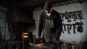 A Man Blacksmith Working with a Hot Metal
