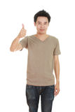 Man in blank brown t-shirt with thumbs up Royalty Free Stock Images