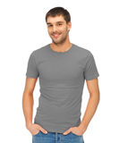 Man in blank grey t-shirt. Clothing design concept - handsome man in blank grey t-shirt Stock Image