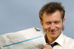 Man with blank newspaper Stock Photography