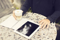 Man with blank notebook, digital tablet and coffee Stock Photos