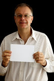 Man with a blank paper in hands Royalty Free Stock Photo