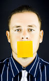Man with blank paper note over his mouth Stock Images