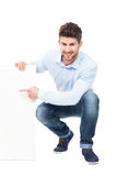 Man with blank poster Royalty Free Stock Photo