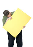 Man and blank sign. A man looking at a blank yellow sign Stock Photography