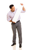 Man blank white board. Middle aged man looking at blank white board on white background Stock Image