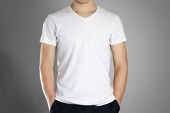 Man in blank white t-shirt. Front. Ready for your design. Hands Stock Photo