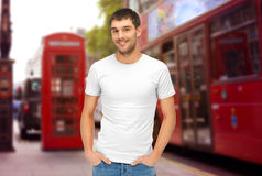 Man in blank white t-shirt over london city street Stock Photography
