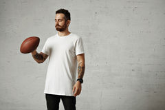 Man in blank white t-shirt with a vintage football Royalty Free Stock Image
