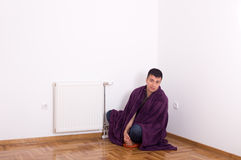 Man with blanket beside heater Stock Photos