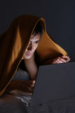 Man in blanket using laptop. On bed Royalty Free Stock Image