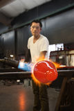 Man Blasting Glass with Flames Stock Images