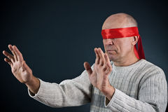 The man, blindfold Stock Images