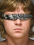 Man with blindfold on one's eyes Royalty Free Stock Photo