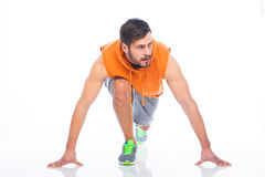 Man in block start. Young sportif man in  position of block start on white background Stock Images