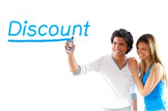 Man and blond girl writing discount. Man and girl writing discount prices with sprayer Stock Photography